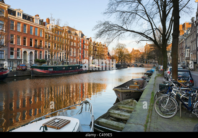 Canal in the late afternoon in the early spring/late winter, Prinsengracht, Grachtengordel south, Amsterdam, Netherlands - Stock Image