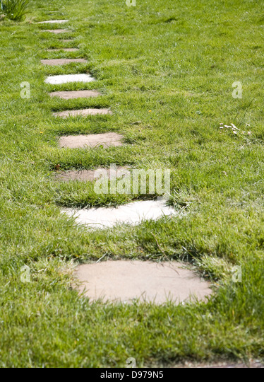 Paving slabs stock photos paving slabs stock images alamy for Stone path in grass