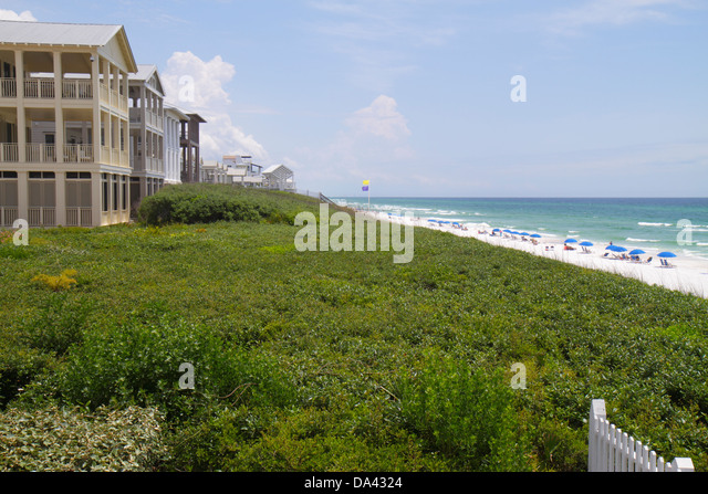 Florida Seaside master-planned community New Urbanism beach Gulf of Mexico coast shoreline sunbathers umbrellas - Stock Image
