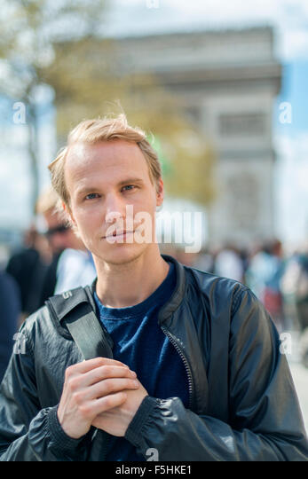 France, Paris, Champs-Elysees, Portrait of mid-adult man - Stock Image
