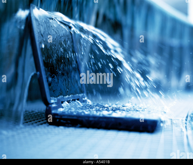 laptop computer in water fountain - Stock Image