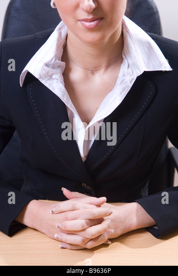 Close up of a business woman sat at her desk - Stock Image