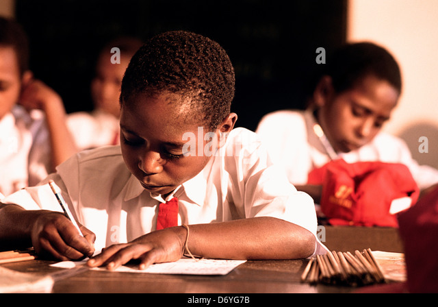 Male students studying in a classroom, Irian Jaya, New Guinea, Indonesia - Stock Image