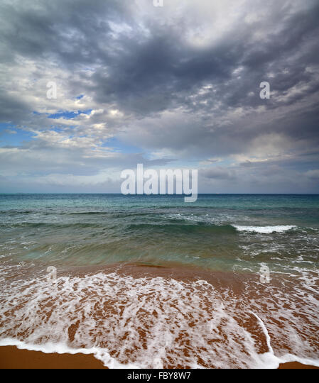 sea landscape with moody sky - Stock Image