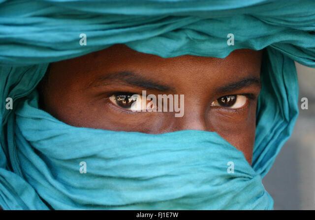 Mali amazing portrait of Tuareg man behind his blue turban - Stock Image