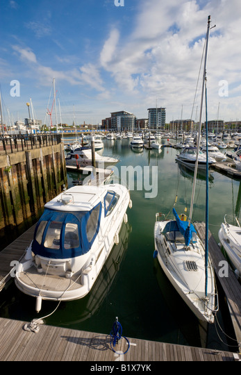 Yachts and luxury motor cruisers moored at Ocean Village Marina Southampton Hampshire England - Stock-Bilder