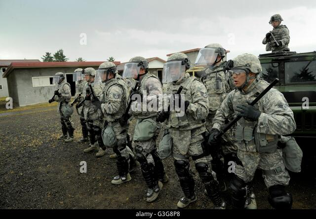 Oregon Air National Guard Security Force members train during riot control operations against simulated protestors - Stock Image