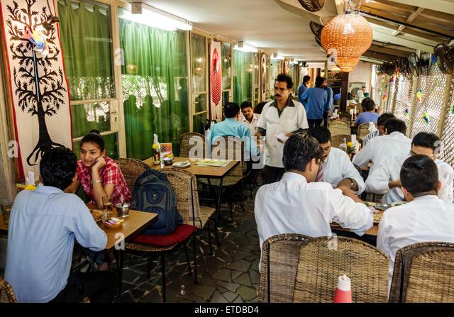 Mumbai India Indian Asian Fort Mumbai Kala Ghoda Jehangir Art Gallery contemporary Cafe Samovar restaurant tables - Stock Image