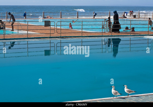 South Africa, Western Cape, Cape Town, Sea Point, outdoor swimming pool on the seaside - Stock Image
