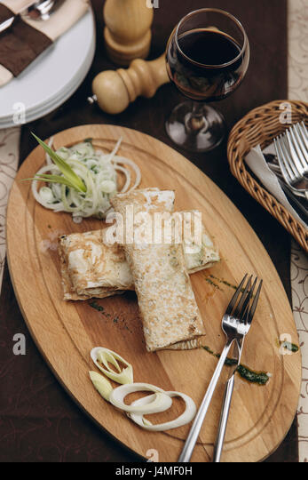 Bread and onions on tray - Stock-Bilder