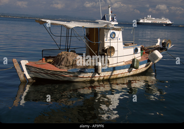 Greece Katakolon Ionian Sea coast fishing boat ms Rotterdam cruise ship - Stock Image