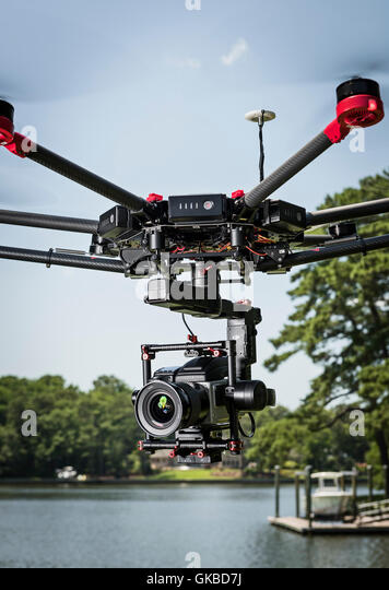 DJI Matrice 600 drone flying with Hasselblad on Ronin Gimbal - Stock Image