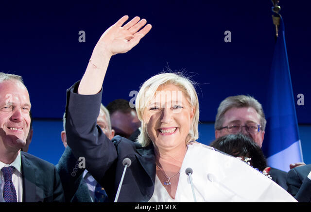 Henin-Beaumont, France. 23rd Apr, 2017. The presidential candidate of Front National, Marine Le Pen (C), receives - Stock Image