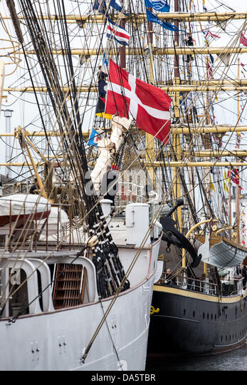 "Aarhus, Denmark. 4th July, 2013. The Danish flag at ""Georg Stage"" during The Tall Ships Races 2013 in - Stock Image"