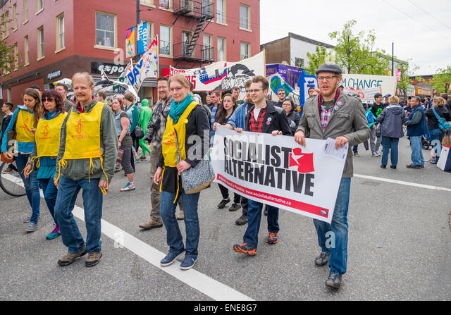 Socialist group  and Amnesty International supporters in 2015 Earth Day Parade Commercial Drive, Vancouver, B.C. - Stock Image