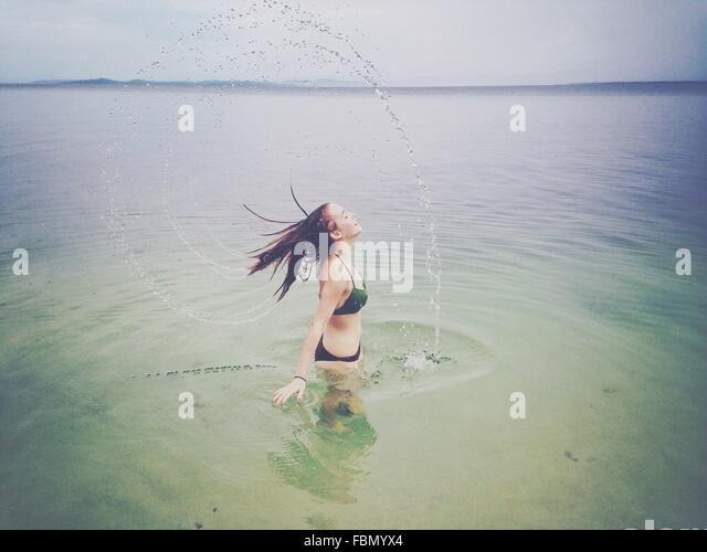 Woman Enjoying In Sea - Stock Image