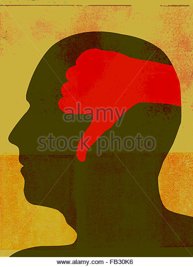 Thumbs down inside of man's head - Stock Image