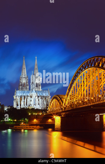 Cologne Cathedral & Hohenzollern Bridge after sunset - Stock Image