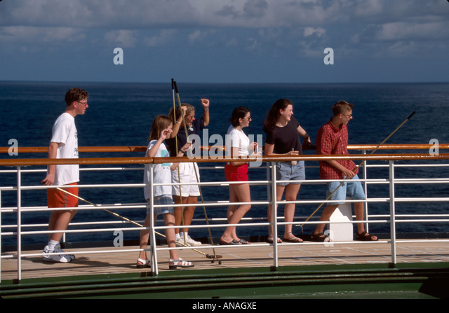 Bahamas Atlantic Ocean Holland America Line ms Maasdam cruise teens shuffleboard - Stock Image