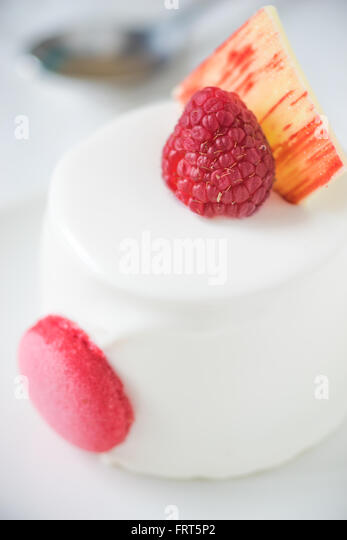White cake with raspberry vertical - Stock Image