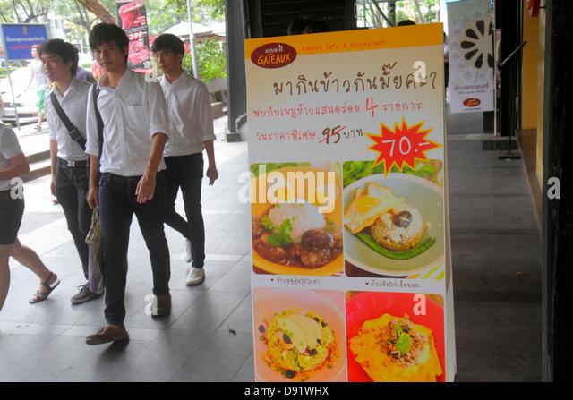 Thailand Bangkok Pathum Wan Rama 1 Road sign promotion bakery cafe restaurant Asian teen boy student - Stock Image