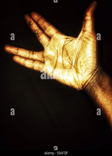Black hand black background - Stock Image