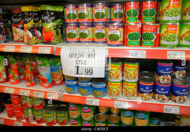 Mendoza Argentina Avenida San Juan grocery store supermarket business shopping shelf shelves packaging brand retail - Stock Image