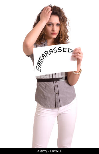 Young attractive woman holding paper with Embarassed text on white background - Stock Image