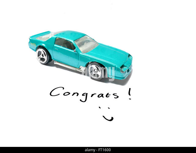 Congratulations Driver's License with old toy car model - Stock Image
