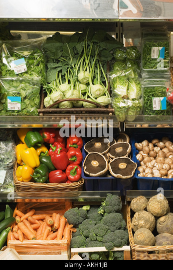 Organic fruit and vegetables in greengrocers - Stock Image