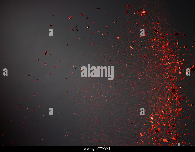 Colorful powder flying in air - Stock Image