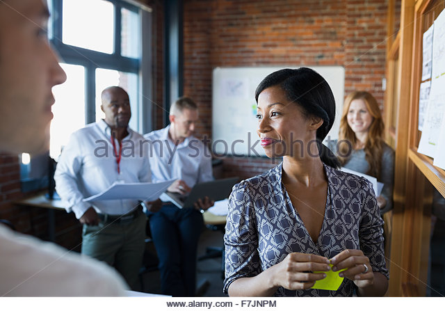 Business people brainstorming in meeting - Stock Image