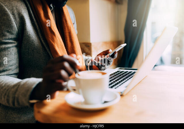 Businessman using his laptop in the Coffee Shop. Business Concept - Stock Image