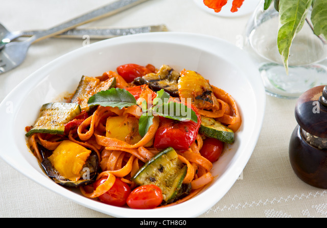 Fettuccine and Grilled vegetables in tomato sauce - Stock Image