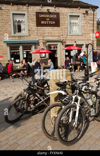 UK, England, Yorkshire, Calderdale, Hebden Bridge, St Georges Square, bicycles outside Shoulder of Mutton pub - Stock Image
