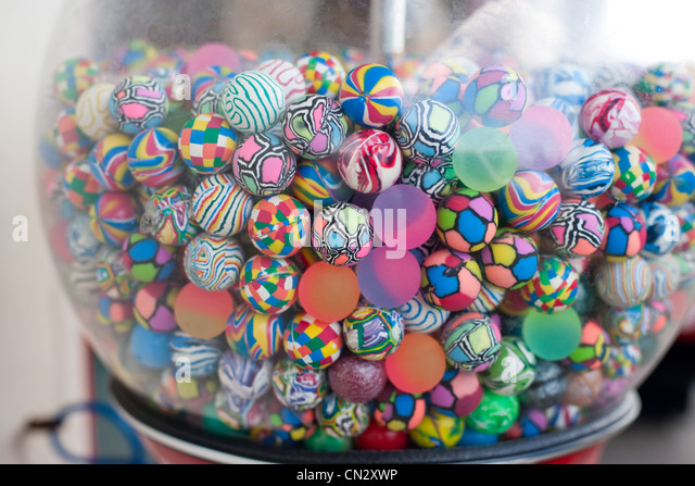 Colorful balls in vending machine - Stock Image