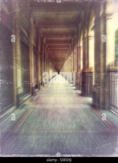 Arcade of Valois Gallery at Palais-Royal early in the morning. 1st arrondissement or district in central Paris, - Stock Image