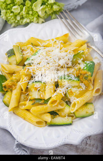 A Close Up View of a Plate of Gluten Free Pasta with Fresh Heirloom Tomato Basil Sauce - Stock Image