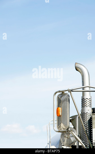 Vertical of truck exhaust against blue sky: global warming, green house gas concept. - Stock Image