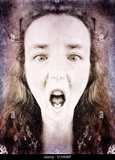 Creepy woman's face, digitally altered, scary/scared - Stock Image