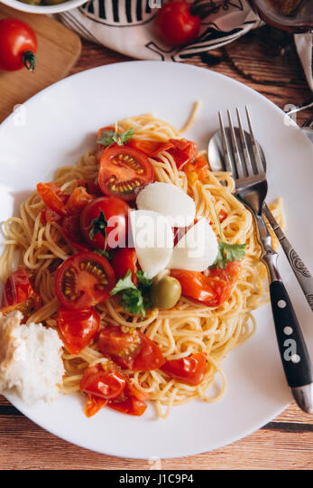 Spaghetti with bread and tomatoes - Stock Image