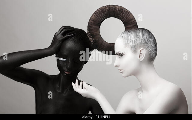 Ying & Yang Symbol. East Culture. Women Painted Body in Black & White - Stock Image