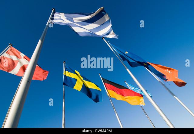 European flags flying against a deep blue sky - Stock Image