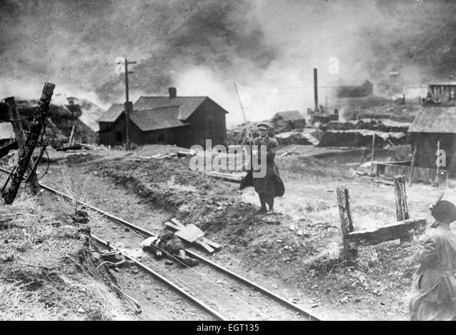 Comrade, after battle, rescuing body of slain miner following the Ludlow Massacre, during which a tent camp of striking - Stock Image