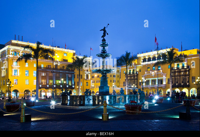 Bronze fountain, City Hall and Union Club in Plaza Mayor, formerly Plaza de Armas, in downtown Lima,capital of Peru - Stock Image