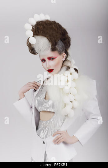 Haute Couture. Extravagant Woman in Cyber Costume and Theatrical Hair-do - Stock Image