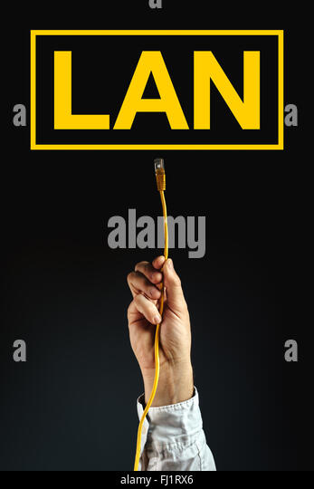 Businessman plugging LAN cable to connect to local area network, business solution. - Stock-Bilder