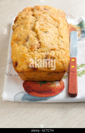 sliced homemade bread with cheese and tomato. - Stock Image