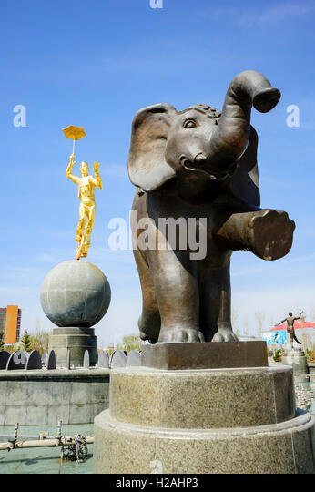 Elephant and Golden Acrobat statues at Moscow Fountain Circus square, Astana, Kazakhstan - Stock Image