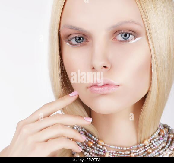 Sophisticated Lovely Blonde Touching Her Face - Stock Image